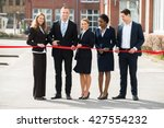 happy businesspeople at opening ... | Shutterstock . vector #427554232