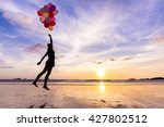 woman in a happy dream flying... | Shutterstock . vector #427802512