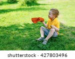swelter. sweaty kid sitting in... | Shutterstock . vector #427803496