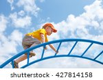 little boy climbs up the ladder ... | Shutterstock . vector #427814158