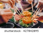 asian people eating sashimi set ... | Shutterstock . vector #427842895