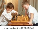two boy playing chess | Shutterstock . vector #427853362