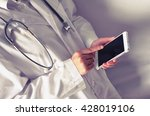 doctor hold smart phone  | Shutterstock . vector #428019106