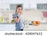 young woman drinking water from ... | Shutterstock . vector #428047612