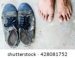 old shoes and dirty feet  on... | Shutterstock . vector #428081752