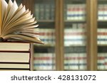 library with books in foreground | Shutterstock . vector #428131072