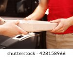 young handsome man delivering... | Shutterstock . vector #428158966