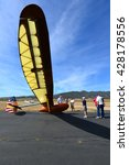 Small photo of TEHACHAPI, CA - MAY 28, 2016: A group of interested admirers congregate around of a Bowlus BA-100 Baby Albatross glider prior to takeoff at Mountain Valley Airport.