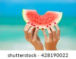hand holding watermelon on the... | Shutterstock . vector #428190022