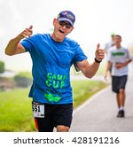 Small photo of BREVARD, NC-MAY 28, 2016 - Agnus Graham, Brevard, NC, runs in the White Squirrel Race with over 350 runners in Brevard, NC 2016. Race is sponsored by Rotary Club of Brevard, NC