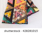 Patchwork Quilt On A White...