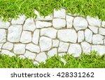 street big rock wall  and grass ...   Shutterstock . vector #428331262