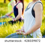 Young Girls Yoga In The Park....