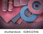 Small photo of Stack of abrasive tools on polishing sheet.