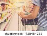 woman with shopping cart....   Shutterstock . vector #428484286