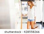 woman tapping an access card | Shutterstock . vector #428558266