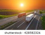 Three Big Trucks Driving...
