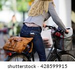 Commuting Business Woman On Bike
