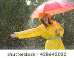 Woman In Raincoat With Umbrell...