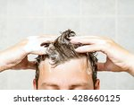 young man washing his hair ... | Shutterstock . vector #428660125