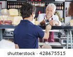salesman accepting payment from ...   Shutterstock . vector #428675515