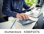business man using a calculator ... | Shutterstock . vector #428691076