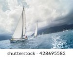 "Small photo of Sailboat coming one after the other with a large roll. Tivat, Montenegro - 26 April, 2016. Regatta ""Russian stream"" in God-Katorskaya bay of the Adriatic Sea off the coast of Montenegro."
