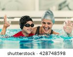 cheerful boy with swimming... | Shutterstock . vector #428748598
