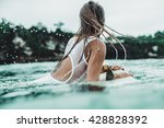 beautiful female surfer looking ... | Shutterstock . vector #428828392