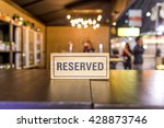 reserved sign on a table in... | Shutterstock . vector #428873746