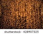 gold swirly bokeh orgia  | Shutterstock . vector #428907325