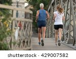 healthy mature couple jogging... | Shutterstock . vector #429007582
