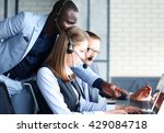Small photo of Phone operator working at call centre office helping hiss colleague