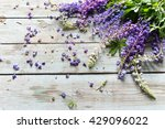 Lupine Flowers On A Wooden...