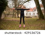 Attractive Woman Doing Jumping...