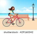 woman cycling on the beach   Shutterstock .eps vector #429160342