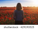 Woman At Blooming Poppy Field....