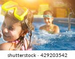 Children Playing In Pool. Two...