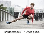 young athletic man stretching