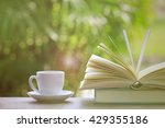 cup of coffee with books on the ... | Shutterstock . vector #429355186
