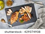 grilled chicken fillets on... | Shutterstock . vector #429374938