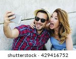 young couple making fan selfie... | Shutterstock . vector #429416752