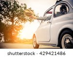 happy couple in the car driving ... | Shutterstock . vector #429421486