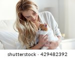 Stock photo pets morning comfort rest and people concept happy young woman with cat in bed at home 429482392