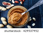 Jar And Spoon Of Peanut Butter...