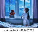 Cute Child Girl Sitting At The...