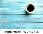 Cup Of Coffee On A Blue Wooden...