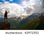 girl  upright on a rock in... | Shutterstock . vector #42972352