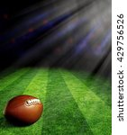 Small photo of American football on green field with spotlights