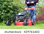 man with lawnmover in garden | Shutterstock . vector #429761602